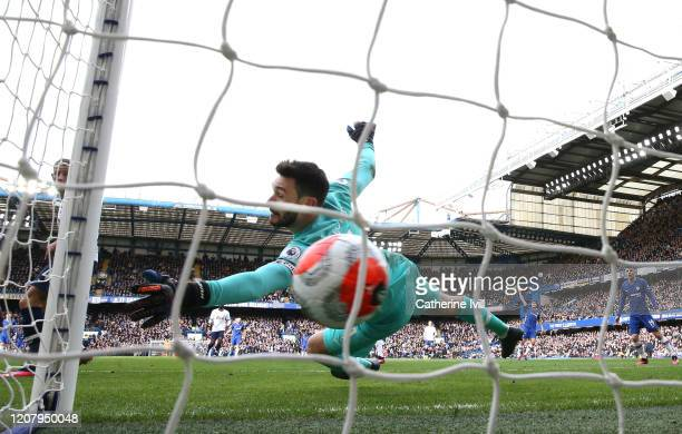 Olivier Giroud of Chelsea scores his teams first goal past Hugo Lloris of Tottenham Hotspur during the Premier League match between Chelsea FC and...