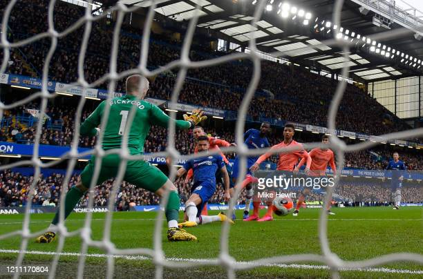 Olivier Giroud of Chelsea scores his team's fourth goal during the Premier League match between Chelsea FC and Everton FC at Stamford Bridge on March...