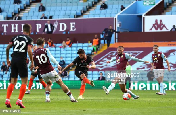 Olivier Giroud of Chelsea scores his teams second goal during the Premier League match between Aston Villa and Chelsea FC at Villa Park on June 21...