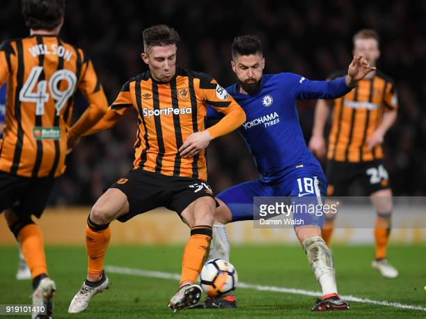 Olivier Giroud of Chelsea scores the fourth goal under pressure from Angus MacDonald of Hull City during the Emirates FA Cup Fifth Round match...