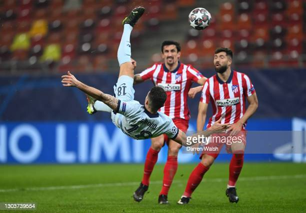 Olivier Giroud of Chelsea scores their side's first goal during the UEFA Champions League Round of 16 match between Atletico Madrid and Chelsea FC at...