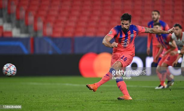Olivier Giroud of Chelsea scores their sides fourth goal from the penalty spot during the UEFA Champions League Group E stage match between FC...