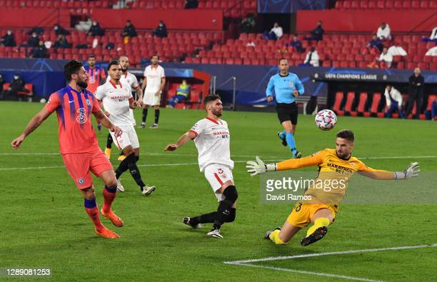 Olivier Giroud of Chelsea scores their sides second goal during the UEFA Champions League Group E stage match between FC Sevilla and Chelsea FC at...