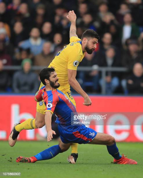 Olivier Giroud of Chelsea shoots while under pressure from James Tomkins of Crystal Palace during the Premier League match between Crystal Palace and...