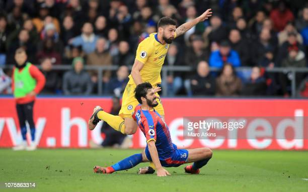 Olivier Giroud of Chelsea shoots while under pressure from James Tomkins of Crystal Palace and picks up a injury during the Premier League match...