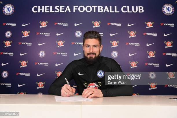 Olivier Giroud of Chelsea signs his contract at Chelsea Training Ground on January 31 2018 in Cobham England