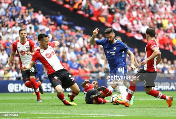 Olivier Giroud of Chelsea takes on Maya Yoshida of Southampton during the The Emirates FA Cup Semi Final match between Chelsea and Southampton at...