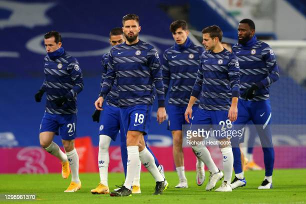 Olivier Giroud of Chelsea warms up with Ben Chilwell and team mates ahead of the Premier League match between Chelsea and Wolverhampton Wanderers at...