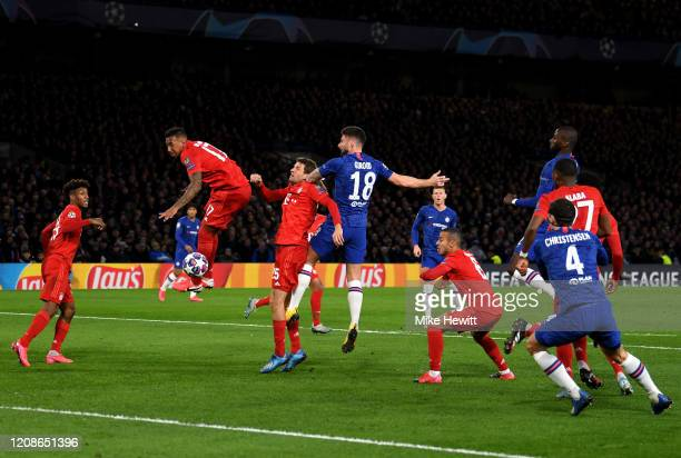 Olivier Giroud of Chelsea wins a header during the UEFA Champions League round of 16 first leg match between Chelsea FC and FC Bayern Muenchen at...