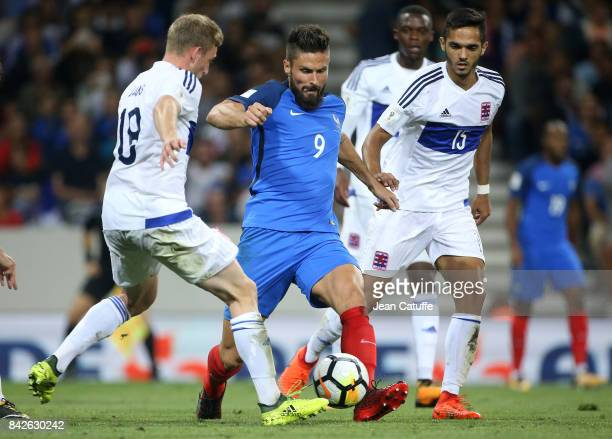 Olivier Giroud of France Aldin Skenderovic of Luxembourg during the FIFA 2018 World Cup Qualifier between France and Luxembourg at the Stadium on...