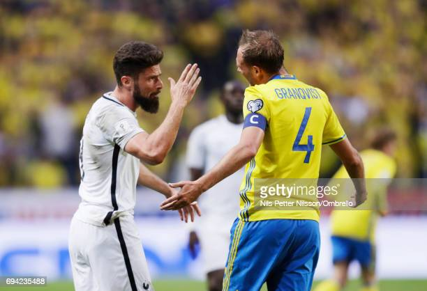 Olivier Giroud of France and Andreas Granqvist of Sweden in a discussion during the FIFA 2018 World Cup Qualifier between Sweden and France at...