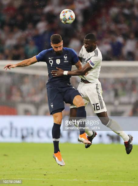 Olivier Giroud of France and Antonio Ruediger of Germany jump for the ball during the UEFA Nations League Group A match between Germany and France at...