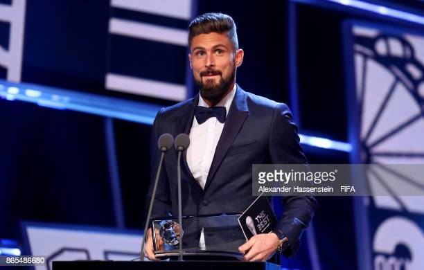 Olivier Giroud of France and Arsenal accepts the Puskas Award during The Best FIFA Football Awards at The London Palladium on October 23 2017 in...