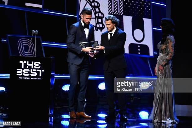 Olivier Giroud of France and Arsenal accepts the Puskas Award from Diego Forlan during The Best FIFA Football Awards at The London Palladium on...