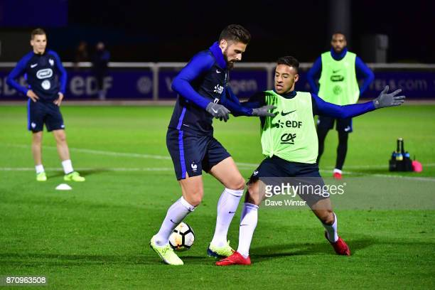 Olivier Giroud of France and Corentin Tolisso of France challenge for the ball as Lucas Digne of France and Alexandre Lacazette of France look on...