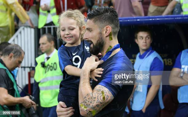 Olivier Giroud of France and his daughter Jade Giroud celebrate the victory following the 2018 FIFA World Cup Russia Final between France and Croatia...
