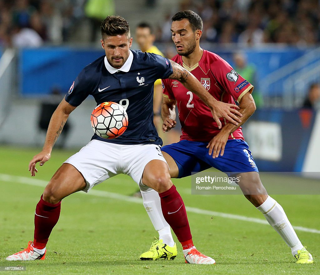 Olivier Giroud of France and Ivan Obradovic of Serbia during the International Friendly game between France and Serbia on September 7, 2015 in Bordeaux, France.