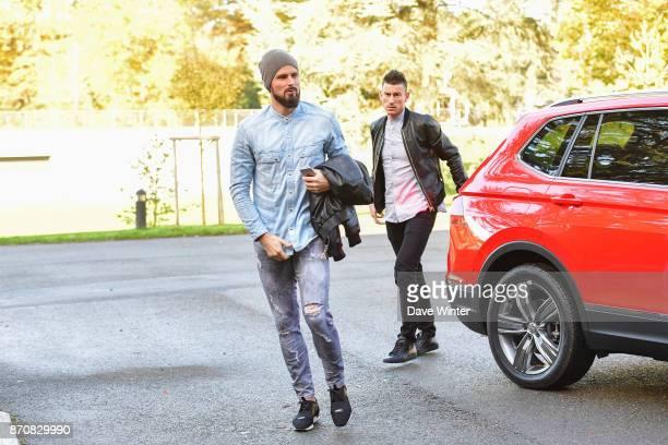 Olivier Giroud of France and Laurent Koscielny of France arrive at the Centre National du Football in Clairefontaine en Yvelines France on November 6...