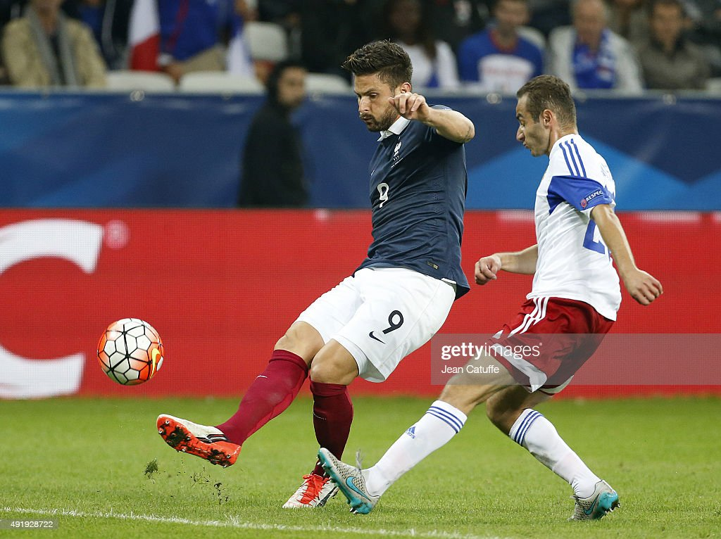 Olivier Giroud of France and Levon Hayrapetyan of Armenia in action during the international friendly match between France and Armenia at Allianz Riviera stadium on October 8, 2015 in Nice, France.