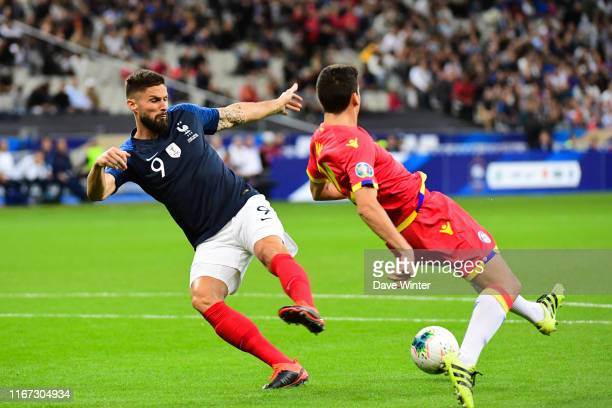 Olivier Giroud of France and Max Llovera of Andorra during the UEFA European Championship 2020 qualifying match between France and Andorra at Stade...