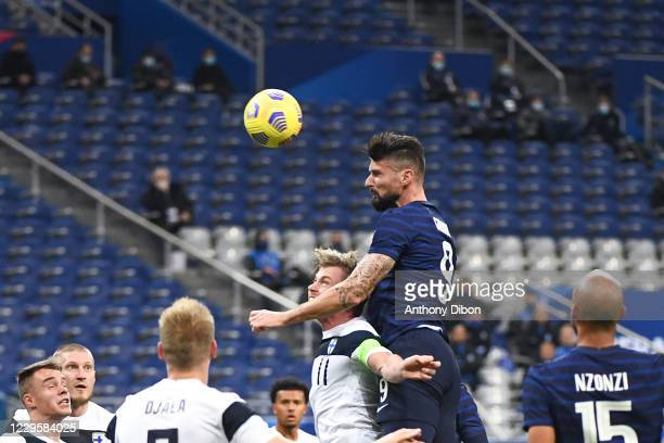 Olivier GIROUD of France and Rasmus SCHULLER of Finland during the international friendly match between France and Finland at Stade de France on...