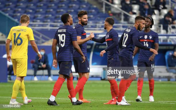 Olivier Giroud of France celebrate his second goal with team-mates during the international friendly match between France and Ukraine at Stade de...