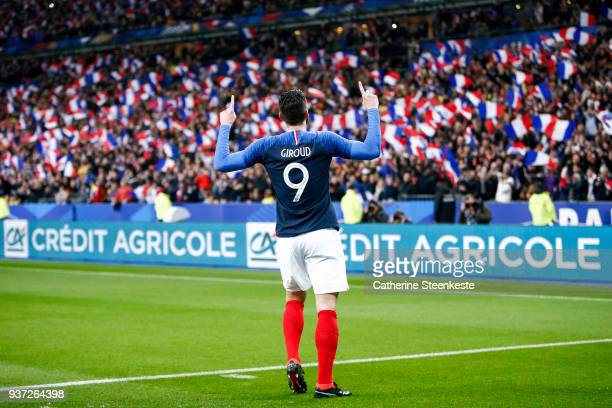 Olivier Giroud of France celebrates after scoring a goal during the international friendly match between France and Colombia at Stade de France on...