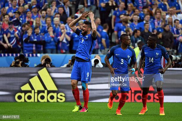 Olivier Giroud of France celebrates after scoring against Iceland during the UEFA EURO 2016 quarter final match between France and Iceland at Stade...