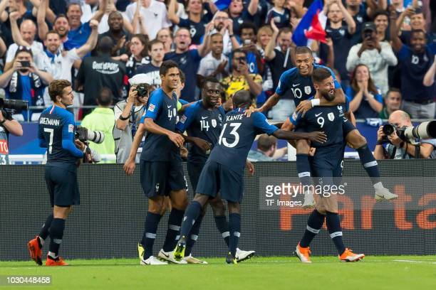 Olivier Giroud of France celebrates after scoring his team`s second goal with team mates during the UEFA Nations League A group one match between...