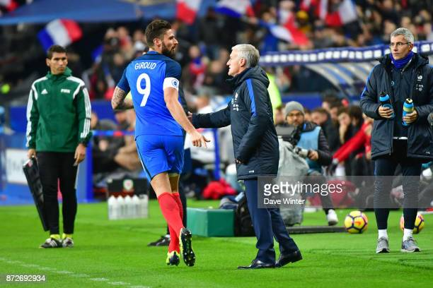 Olivier Giroud of France celebrates his goal with France coach Didier Deschamps during the international friendly match between France and Wales at...