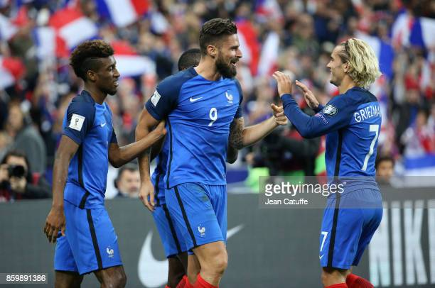 Olivier Giroud of France celebrates his goal with Kingsley Coman and Antoine Griezmann during the FIFA 2018 World Cup Qualifier between France and...