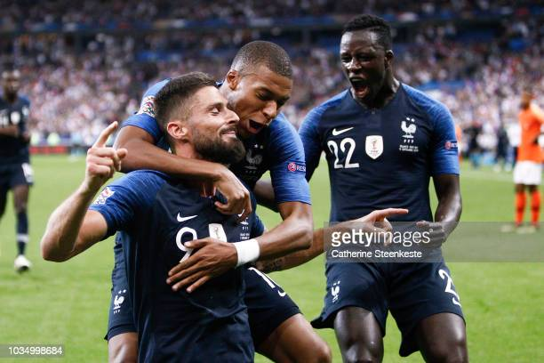 Olivier Giroud of France celebrates his goal with Kylian Mbappe and Benjamin Mendy of France during the UEFA Nations League A group one match between...