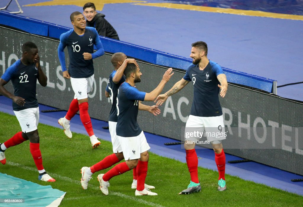 Olivier Giroud of France (right) celebrates his goal with teammates during the international friendly match between France and Republic of Ireland at Stade de France on May 28, 2018 in Saint-Denis near Paris, France.