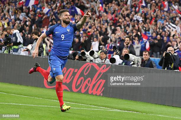 Olivier Giroud of France celebrates his second goal during the UEFA EURO 2016 Quarter Final match between France and Iceland at Stade de France on...