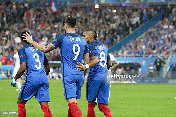 Olivier Giroud of France celebrates his second goal with Patrice Evra and Dimitri Payet of France during the UEFA EURO 2016 Quarter Final match...