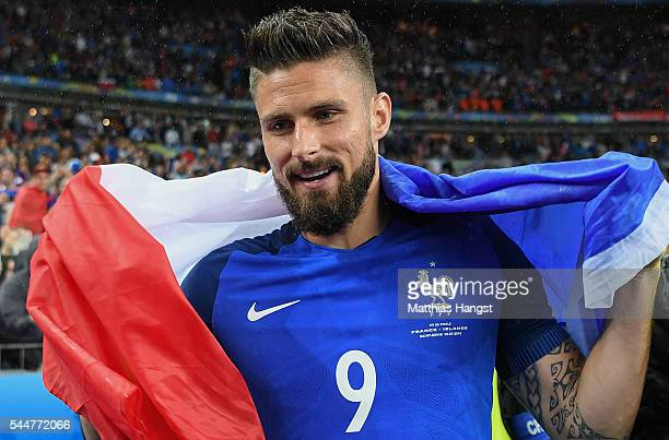 Olivier Giroud of France celebrates his team's 52 win after the UEFA EURO 2016 quarter final match between France and Iceland at Stade de France on...