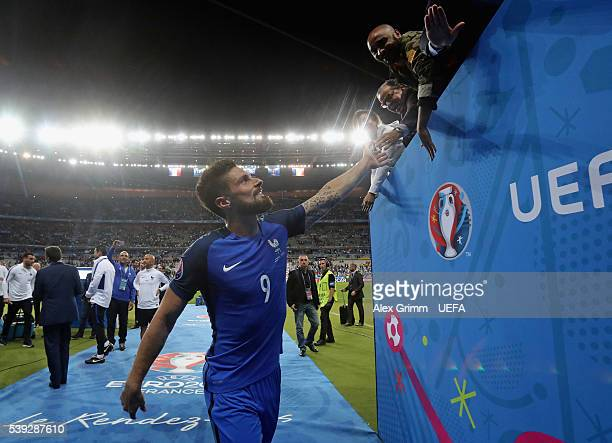 Olivier Giroud of France celebrates his team's win with supporters after the UEFA Euro 2016 Group A match between France and Romania at Stade de...