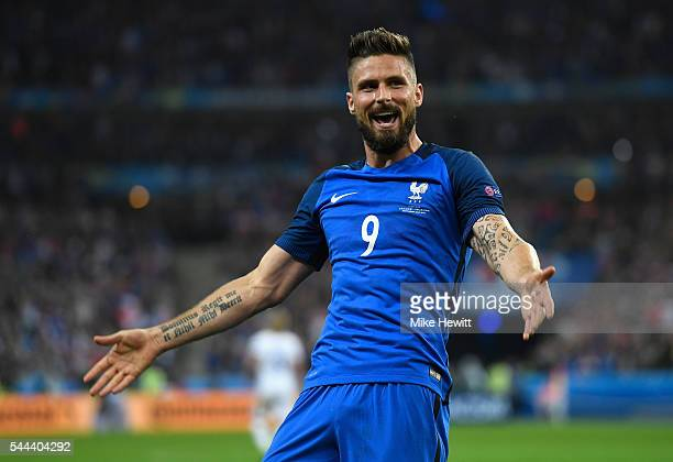 Olivier Giroud of France celebrates scoring his team's fifth goal during the UEFA EURO 2016 quarter final match between France and Iceland at Stade...