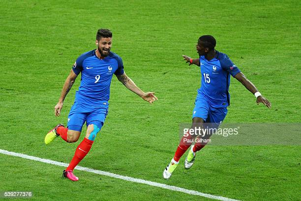 Olivier Giroud of France celebrates scoring his team's first goal with his team mate Paul Pogba during the UEFA Euro 2016 Group A match between...