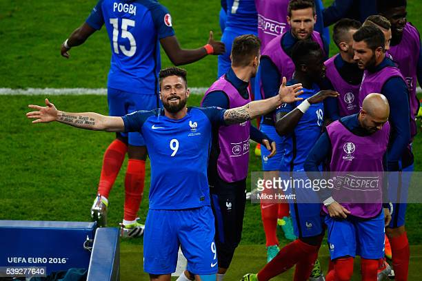 Olivier Giroud of France celebrates scoring his team's first goal with his team mates during the UEFA Euro 2016 Group A match between France and...