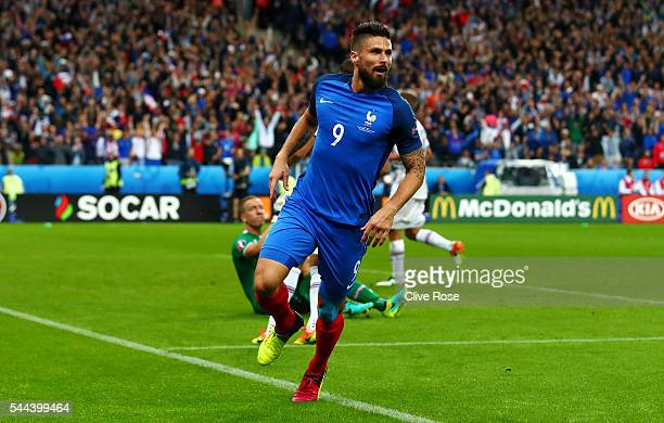 Olivier Giroud of France celebrates scoring the opening goal during the UEFA EURO 2016 quarter final match between France and Iceland at Stade de...