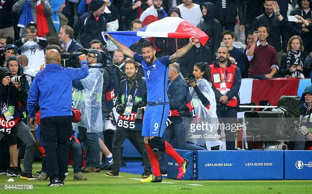 Olivier Giroud of France celebrates the victory following the UEFA Euro 2016 quarter final match between France and Iceland at Stade de France on...
