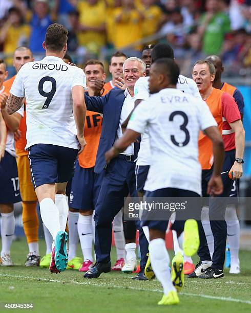 Olivier Giroud of France celebrates with head coach Didier Deschamps after scoring his team's first goal during the 2014 FIFA World Cup Brazil Group...