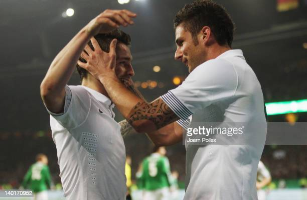 Olivier Giroud of France celebrates with his team mate Mathieu Debuchy after scoring his team's first goal during the International friendly match...