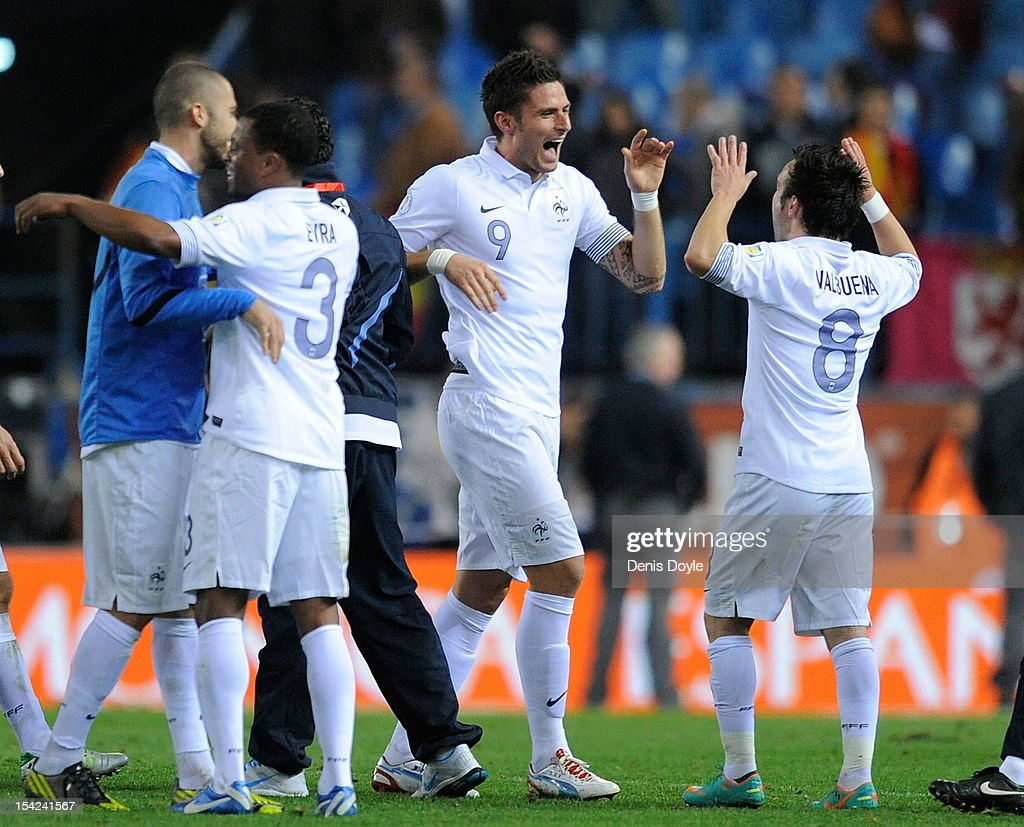 Olivier Giroud (#9) of France celebrates with teammate Mathieu Valbuena at the end of the FIFA 2014 World Cup Qualifier between Spain and France at estadio Vicente Calderon on October 16, 2012 in Madrid, Spain. The match ended a 1-1 draw.