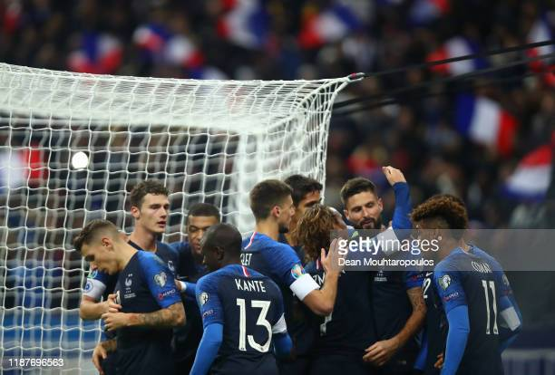 Olivier Giroud of France celebrates with teammates after scoring his team's second goal during the UEFA Euro 2020 Qualifier between France and...