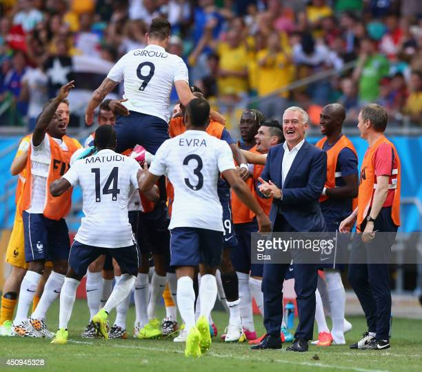 Olivier Giroud of France celebrates with teammates after scoring his team's first goal during the 2014 FIFA World Cup Brazil Group E match between...