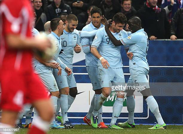 Olivier Giroud of France celebrates with team-mates Mamadou Sakho , Raphael Varane, Karim Benzema and Franck Ribery after scoring the opening goal of...