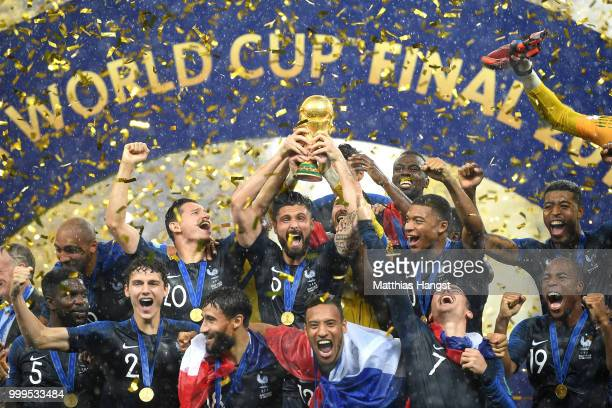 Olivier Giroud of France celebrates with the World Cup Trophy and his teammates following his sides victory in the 2018 FIFA World Cup Final between...