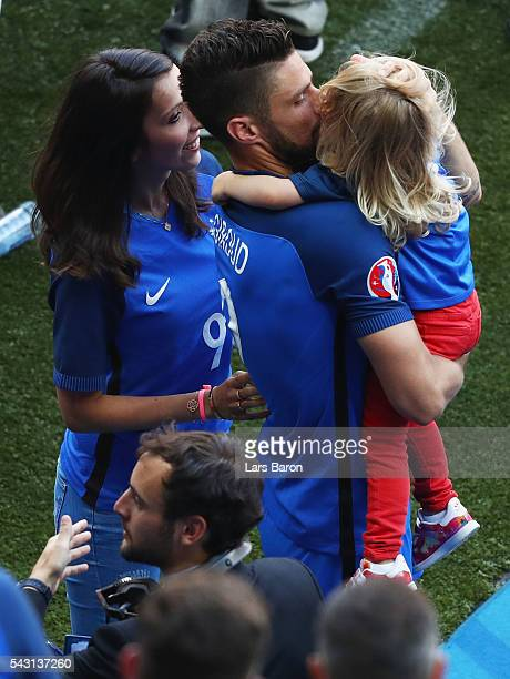 Olivier Giroud of France cleebrates his team's 2-1 win with his wife Jennifer and daughter Jade after the UEFA EURO 2016 round of 16 match between...